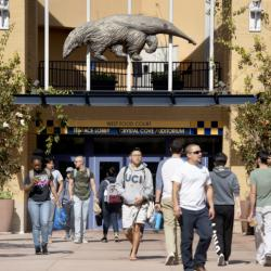 UCI Students walk along the Student Center terrace at UCI