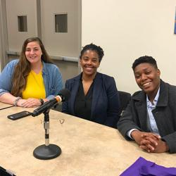 Panelists student Jenna Gotte, AVC Hayashida, and Womxn's Hub program coordinator Adrian Williams sit smiling at the camera