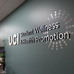 Center for Student Wellness & Health Promotion logo on wall of center
