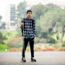 Student Gordon Wong posing on campus